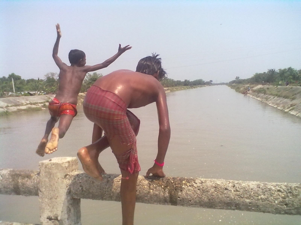 Children Jumping onto the River