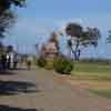 People walking towards Mahabalipuram Seashore temple