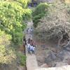 People walking towards to cave temple at Mahabalipuram