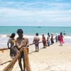 Fishing nets pulled by Fishermen at Tuticorin seashore area