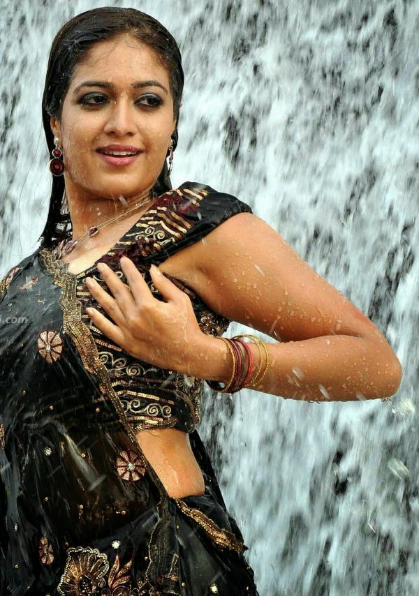 Meghana Raj Hot Navel Saree Photos
