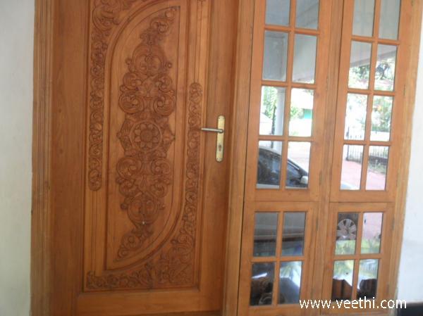 Front door displaying kerala architecture veethi for South indian main door designs